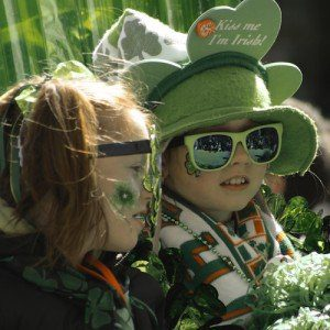 Two young girls decked out in green shamrock regalia for a St. Partick's Day parade.