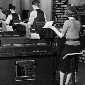 Accountants in the 1950s work hard at their machines.