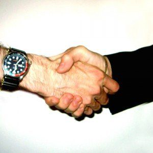 A firm, business-like handshake.
