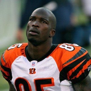 Chad Ochocinco, the football player who legally changed his last name to his jersey number, on the sidelines of a game.