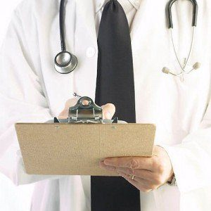 A doctor holding a clipboard, ready to answer your questions.