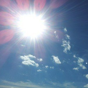 The sun burns white-hot on a beautiful day, the sky blue and nearly cloudless.
