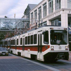 Tri-Met's famous MAX light rail vehicle passing Pioneer Place mall in the heart of downtown Portland.