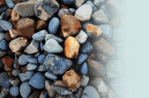Closeup of multicolored beach stones.