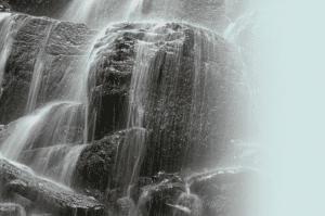 Long exposure of water rushing over rocks.