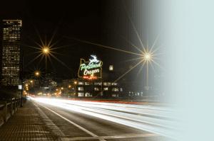 Long exposure of Burnside Bridge in Portland, Oregon at night illustrating the movement of cars.