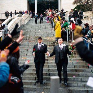 Recently married couples leaving the City Hall in Seattle are greeted by well-wishers on the first day of same-sex marriage in Washington state after enactment of Washington Referendum 74