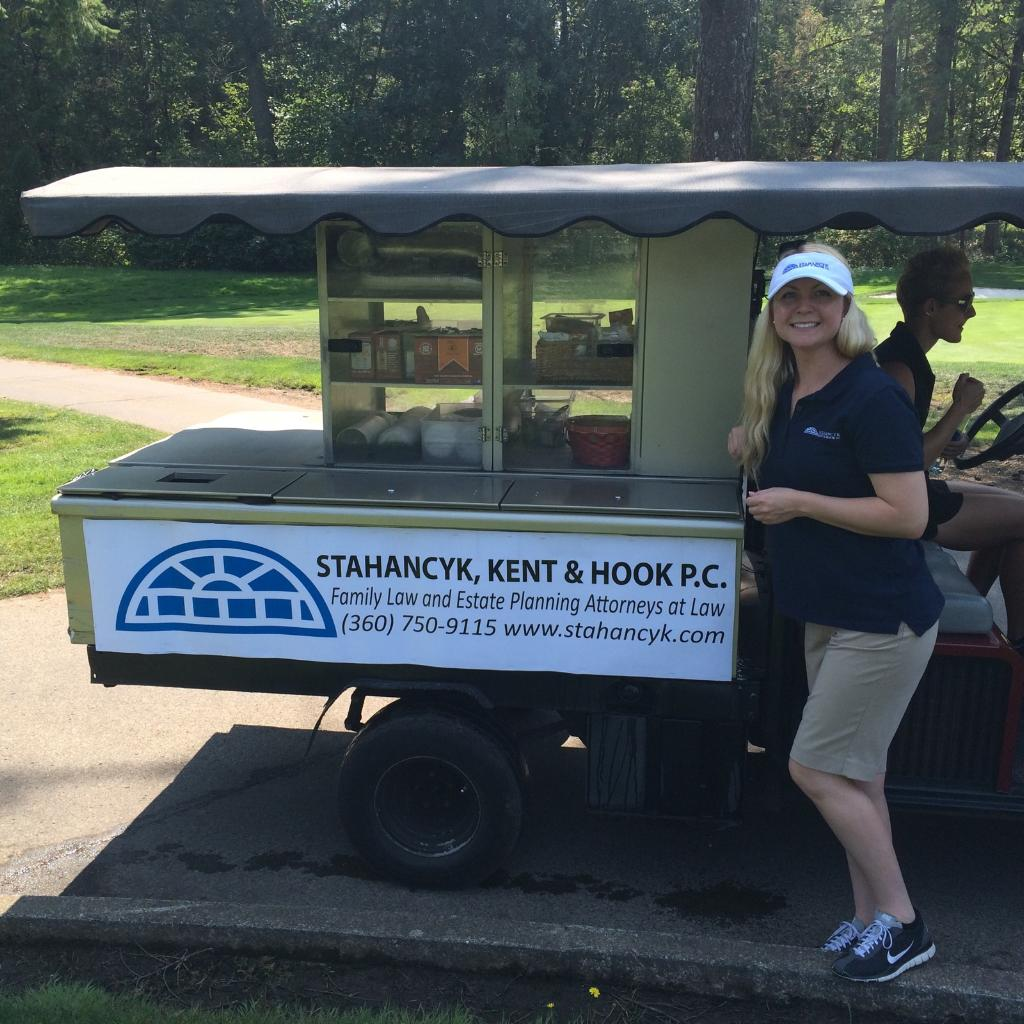 Legal Assistant Krystal Provencher hosts the drinks cart at the Greater Vancouver Chamber of Commerce first annual women's golf tournament at Camas Meadows golf club.