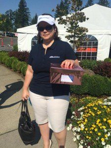 SKH shareholder Michelle Prosser hosts the card drop raffle at the Greater Vancouver Chamber of Commerce first annual women's golf tournament at Camas Meadows golf club.