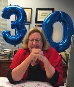 Jody celebrates the firm's 30 years at our impromptu party!