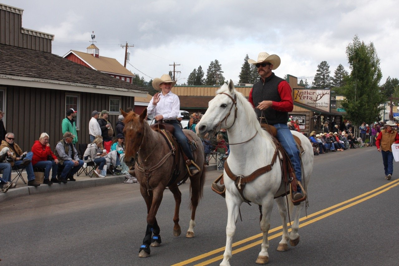 Two Men on horses in the  Sisters Rodeo Parade