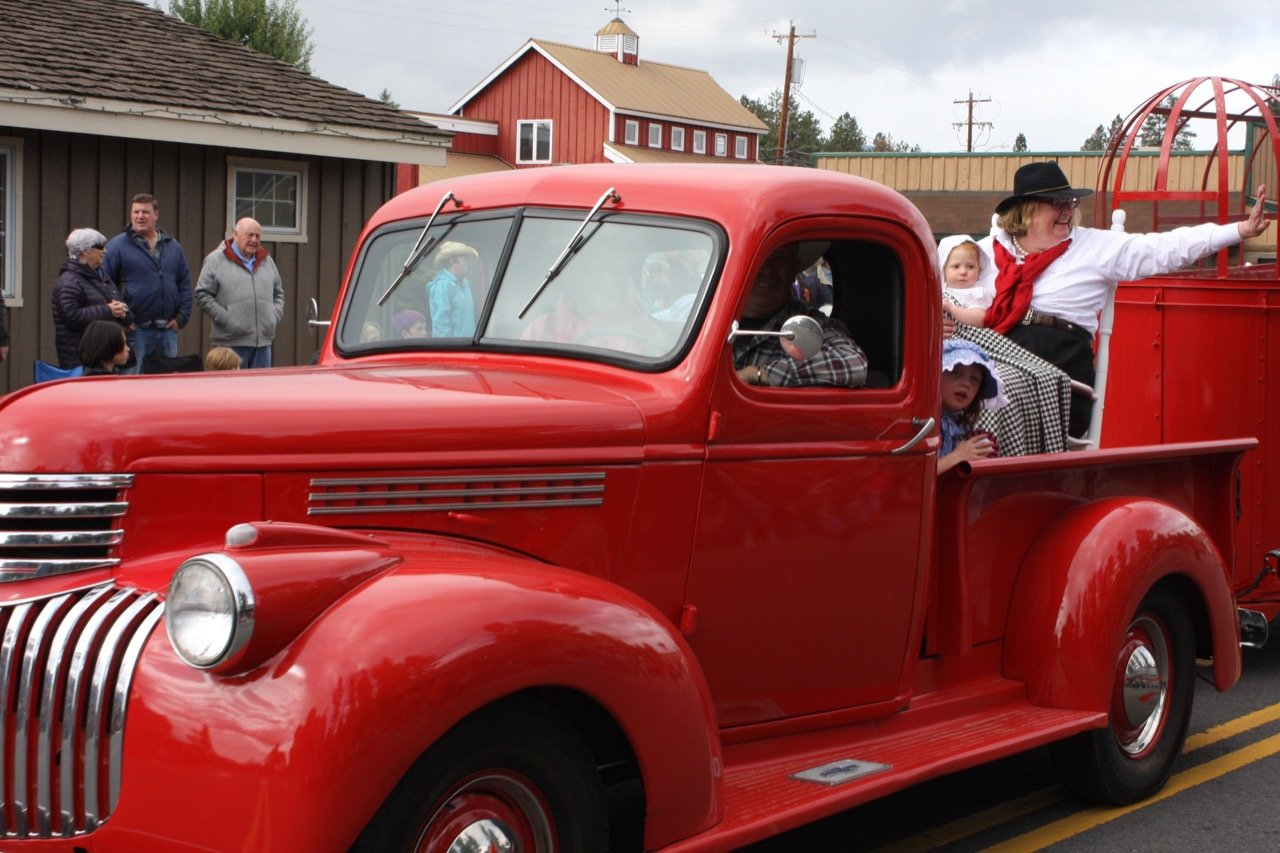 Jody Stahancyk Grand Marshal of the Crooked River Roundup 2017 in an old red truck